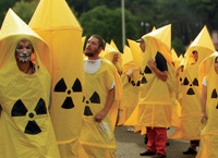 Students wearing yellow suits with nuclear symbol