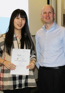 Xin Zhang recieves her first prize from Jonathan Daplyn