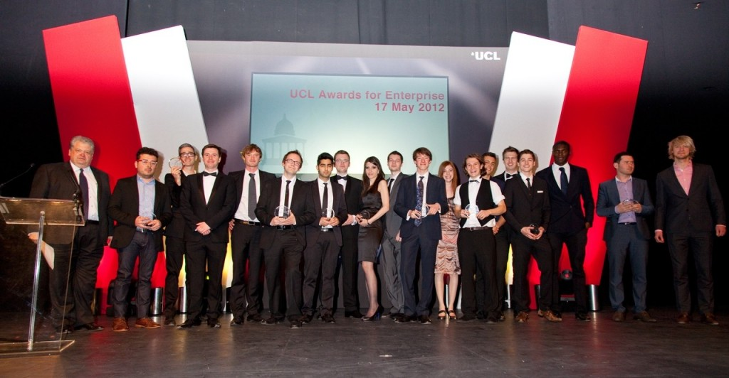 A group shot of all winners of Bright Ideas Awards, on stage at the Bloomsbury Theatre