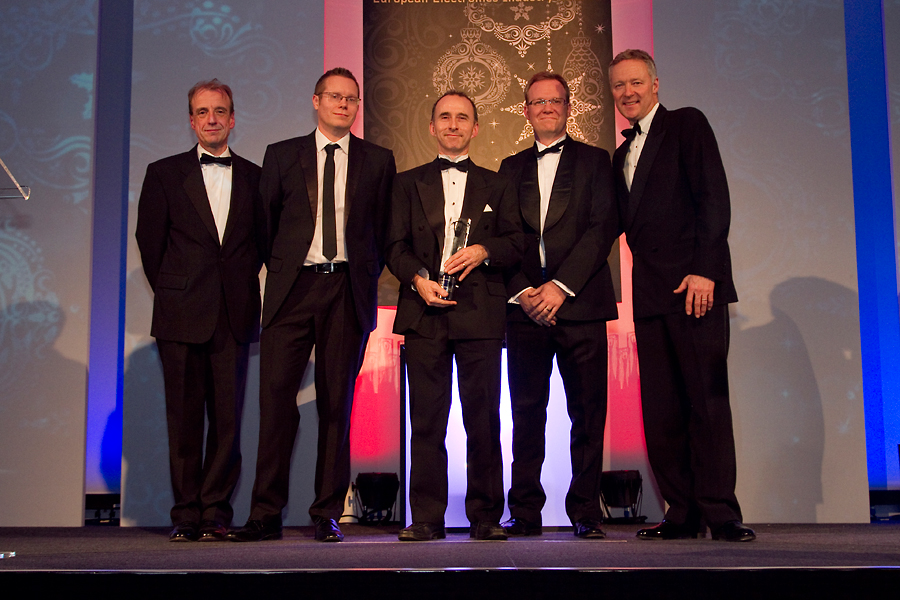Dr John Mitchell and Professor Paul Brennan collect the University Department of the Year European Electronics Industry Award for UCL Electronic & Electrical Engineering from Rory Bremner