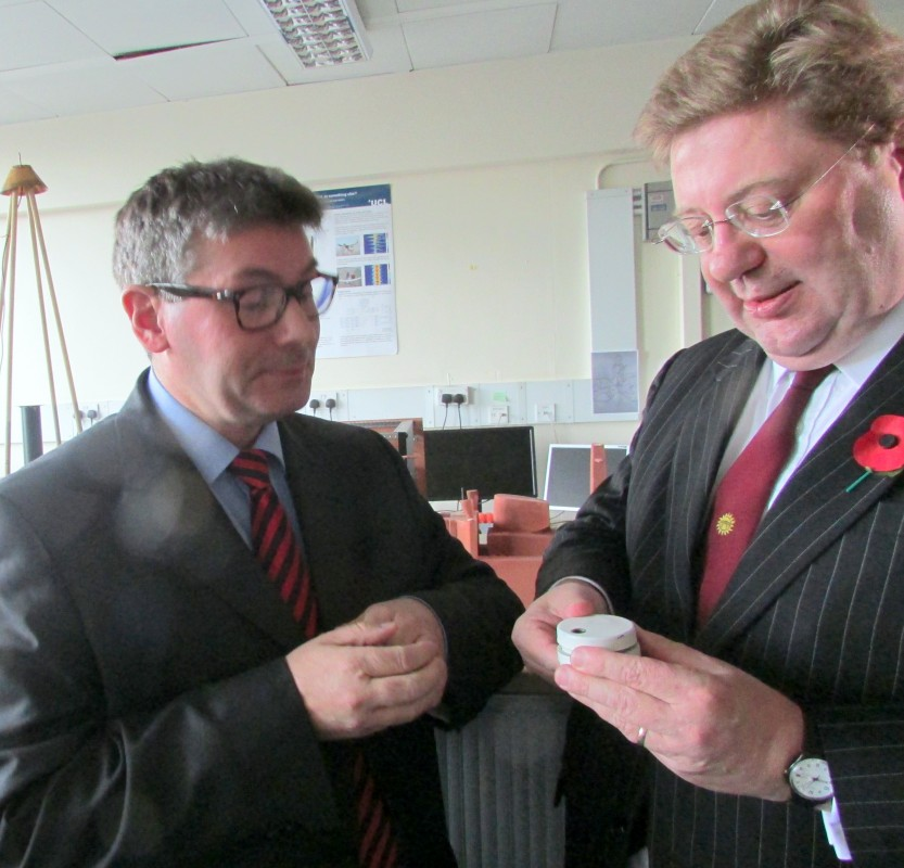 Professor Hugh Griffiths of UCL holds a landmine