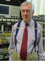 Professor Alwyn Seeds, Director of the National Dark Fibre Infrastructure Service with optical networking equipment at UCL.