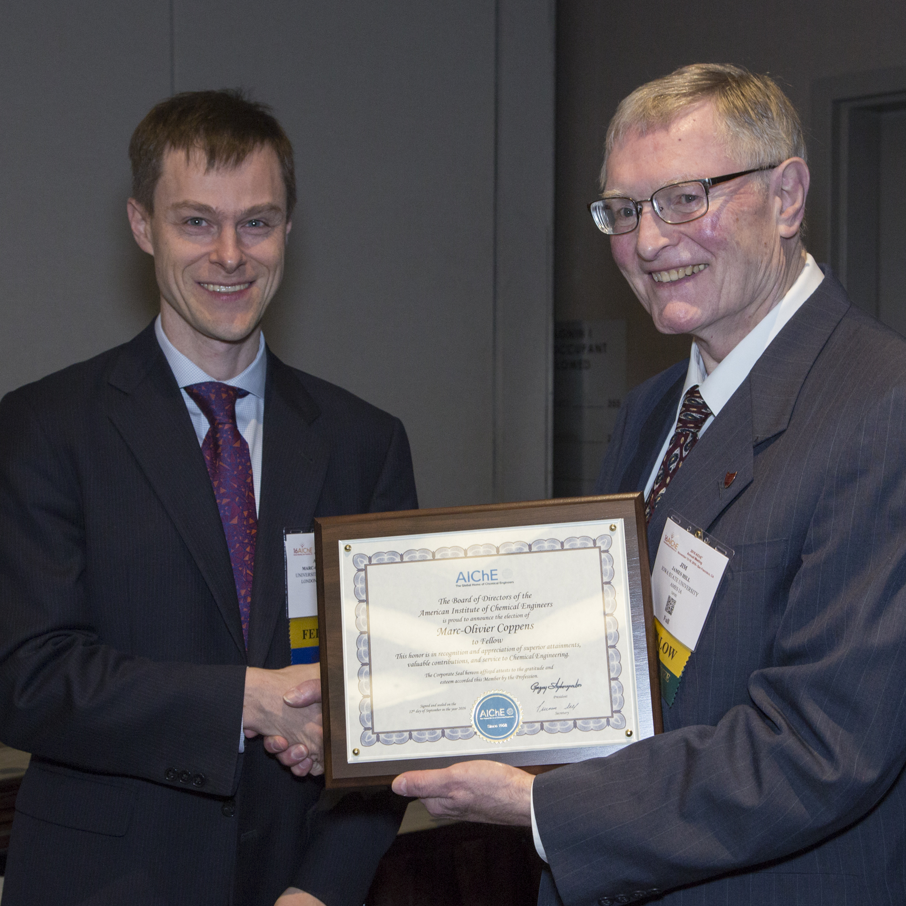 Professor Marc-Olivier Coppens (left) awarded AIChE Fellow plaque, San Francisco Photo credit: Margot Hartford