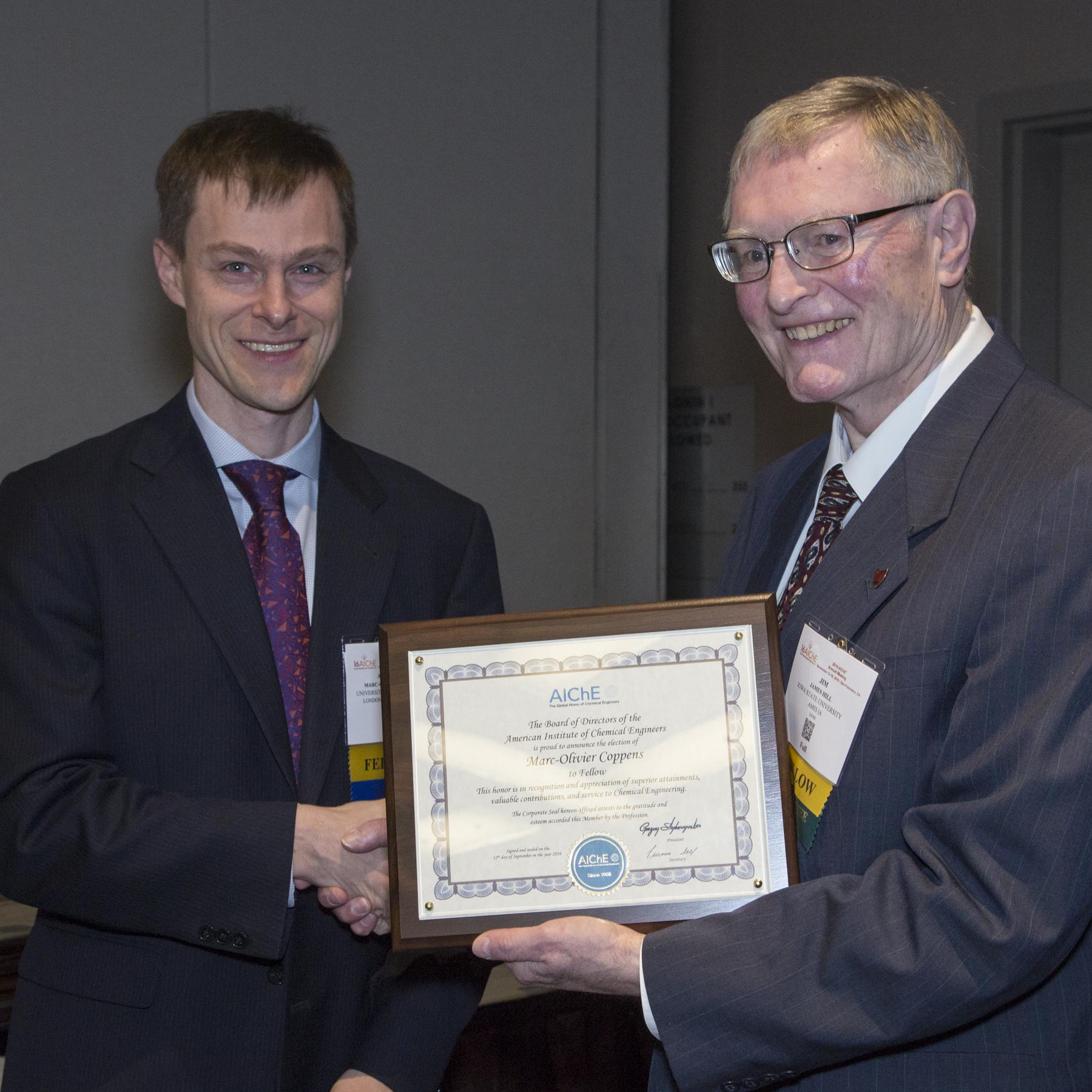 Professor Marc-Olivier Coppens (left) awarded AIChE Fellow plaque, San Francisco Photo credit: Margot Hartford