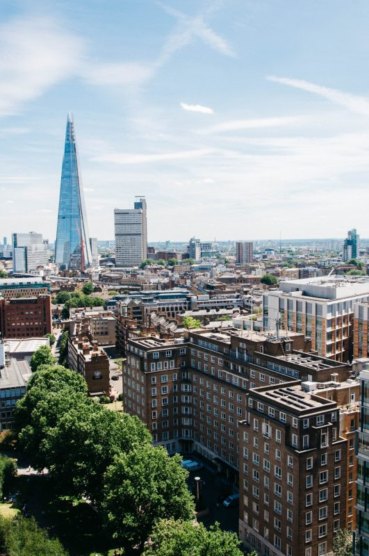 London skyline featuring the Shard and trees. Photo by Clifford Yeo on Unsplash.